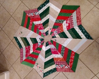 Quilted Christmas tree skirt. 48 inches and opens to expand.