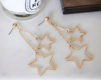 Earrings with dangling stars
