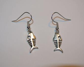 pair of fish skeleton earrings