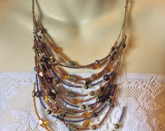 Coldwater Creek 14 strand glass and metal beads necklace .