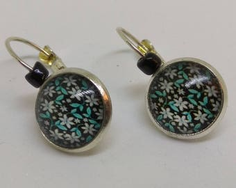 loop earrings 925 sterling silver cabochon, white flowers on a black background, green leaves