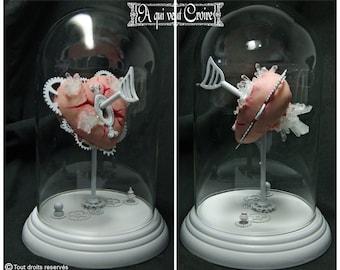Heart of Golem under glass Bell mechanical mechanical heart