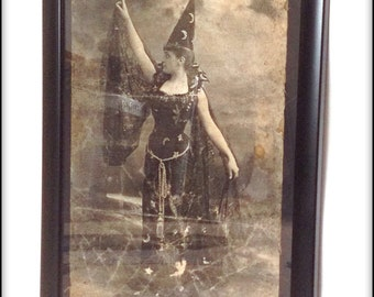 Aged reproduction print of a Victorian witch.