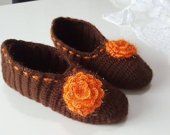 A pair of slippers wool glitter Orange and Brown for women