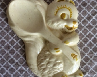 Vintage squirrel wall plaque - holding spoon - ceramic yellow and white