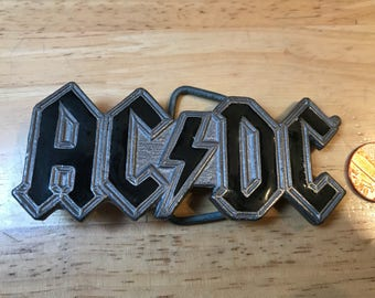 Great American Buckle. AC DC  Made in USA 1992. Good condition Serial number 3071.Size ~ 100x40 mm