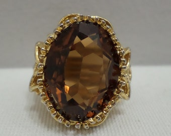 18K HGE gold ring with a brown amber colored stone size 7 costume jewelry