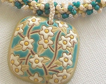 Golem Designer Turquoise and Cream Ceramic Floral Pendant with Handwoven Kumihimo Beaded Rope by Carol Wilson of Je t'adorn