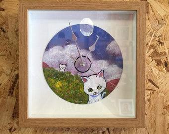 Framed clock made from a hand painted 7 inch single/vinyl record