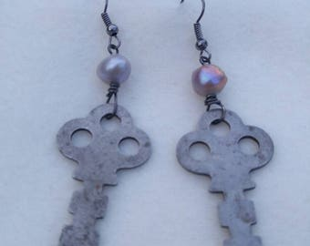 Trunk key and pearl earrings