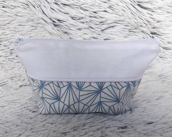 Toiletry blue geometric pattern, yoke and white piping