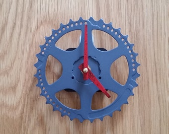 bike gear wall clock, gray with red hands