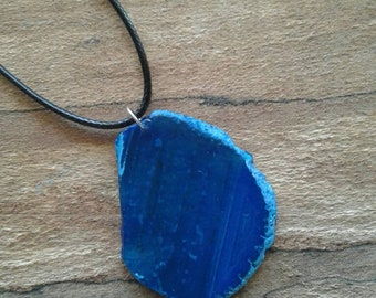 Blue agate slice gemstone pendant with black waxed cord
