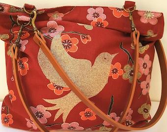 Handmade flower with a bird motif tote bag