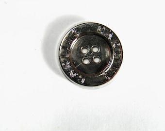 Silver colored plastic button