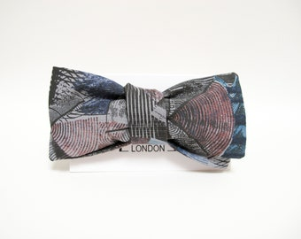 Morden pop art effect wheels print batwing bow tie, blue red and black