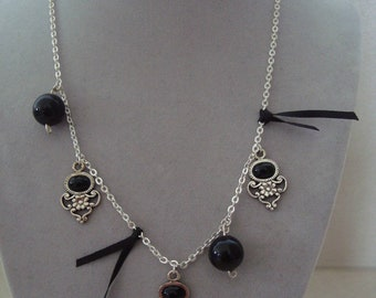 Black necklace on silver plated chain