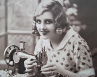 postcard of a dressmaker, vintage postcard