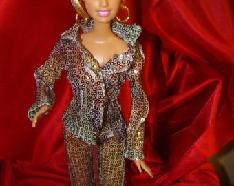 Barbie in a sequin pant suit, green gold