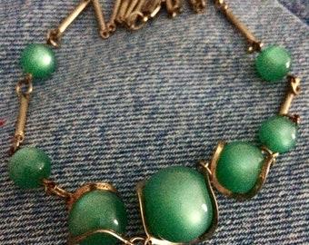 Vintage gold tone green moonglow choker.