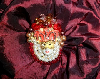 baroque brooch with gold and orange Venetian mask