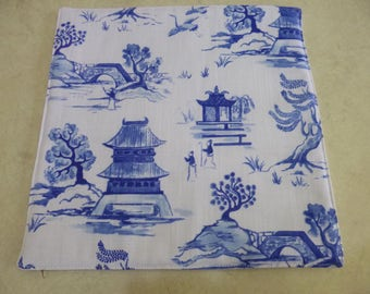 Heat Mat - Pagoda Design.   25cm x 25 cm.  Insulated to protect table top.  Pretty and practical.   Placemats and coasters also available.