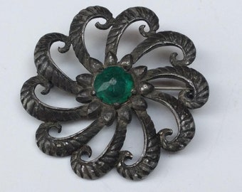 Arts and Crafts era Pewter Brooch with Green Glass Cabachon