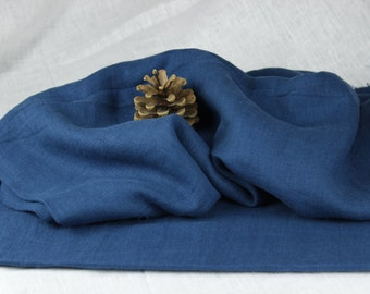 Blue color 100 % washed Linen fabric (200 g/m2). Densely woven, softened, washed linen blue color fabric