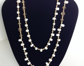 Beautiful Rice Pearls and Crystals Necklace.  Add this Elegant looking necklace to your wardrobe.