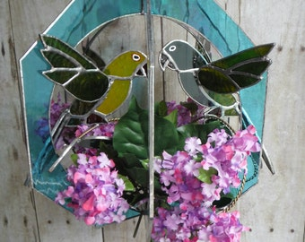 Green Cheek Conure Pair Fashioned in  3-D, Lilac Flower Accents, Stained Glass Whirl, Handmade Suncatcher
