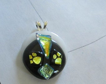 Fused glass black and white paw print pendant with dichroic accents