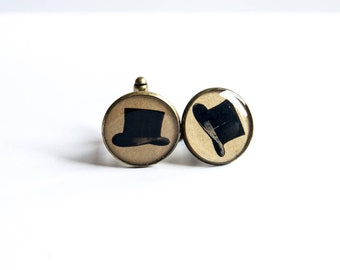 Cuff links. The hat. Vintage engraving. brass and resin