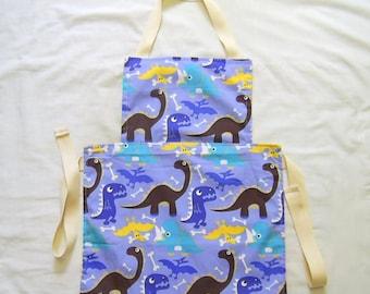 Children's Apron, Dinosaur fabric, Reversible Apron, Craft Apron, Art Apron, Baking Apron, Kids Messy Play Apron, Childs Apron, Full Apron,