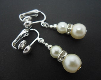 A pair of pretty ivory colour glass pearl  bead  clip on dangly earrings.
