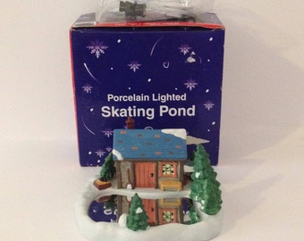 Porcelain Bisque Lighted Ice Skating Pond Rink Cabin Out House Village Christmas Cottage Hut Scene Pine Trees Snow Frozen Lake