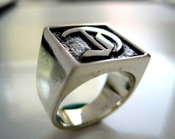 Silver ring with engraved initial