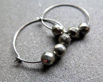 hypoallergenic hoop earrings. dark silver niobium hoops. gold pyrite jewelry.