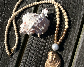 Gold oyster shell Necklace