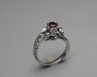 Dragon rings with gemstone tower