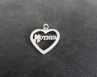 stunning vintage sterling silver mother heart charm