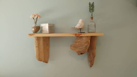 Hanging shelf with cedar top and driftwood accents.