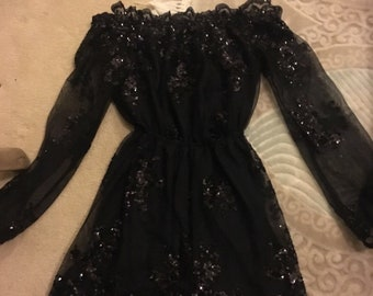 Sparkly black playsuit