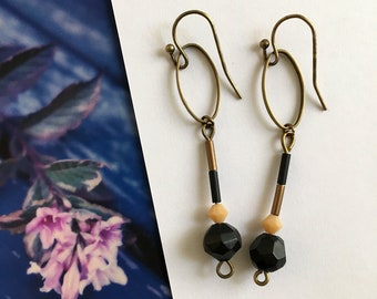 Asymmetrical earrings and delicate Sophie