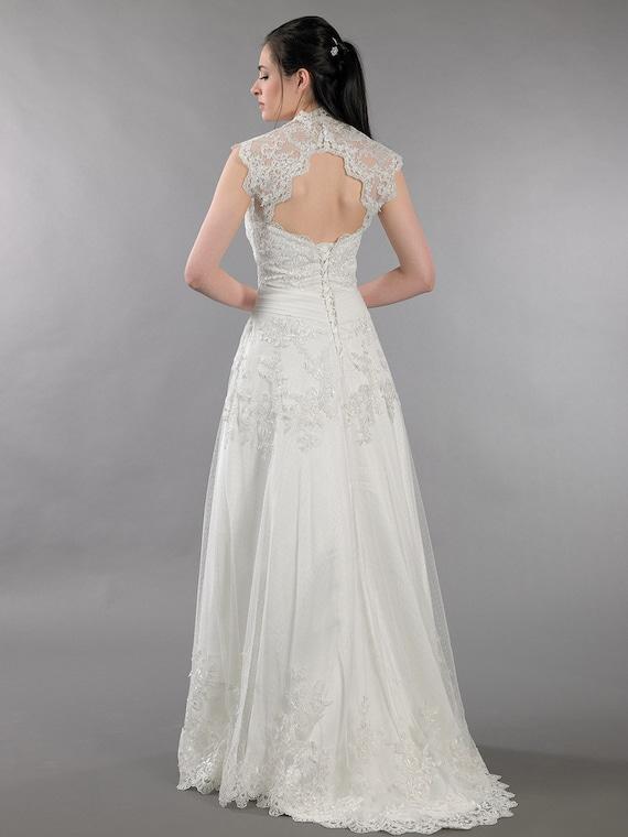 Lace wedding dress with corset back keyhole back bolero