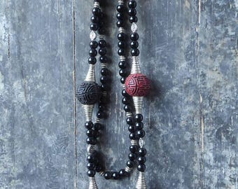 Asian cinnabar and black glass beads necklace and tassel