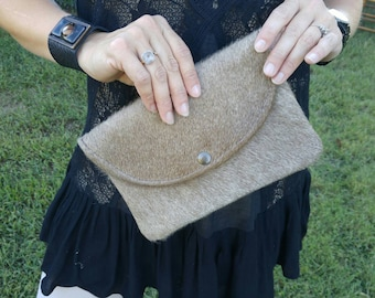 This taupe cowhide clutch is the perfect color!