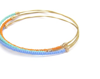Beaded Bracelet Stack // Set of 3 Bangle Bracelets // Thin Gold Bangle Bracelets / Eco-Friendly Jewelry / Turquoise Purple Orange Seed Beads