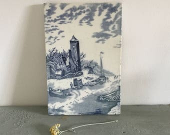 Vintage Dutch Delft tile blue and white, winters canal scene.