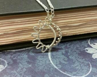 Silver wire sun and moon pendant