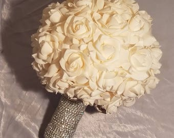 Faux floral bouquet with matching boutonniere